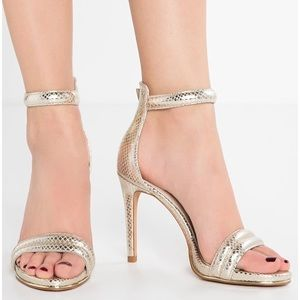 Kenneth Cole ankle strap gold heel.